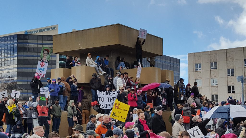 "Photo of protest. ""Power to the people"" sign in center"