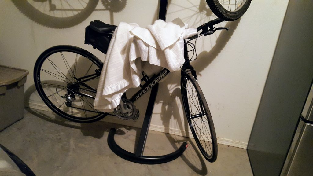The Cannondale under a blanket.